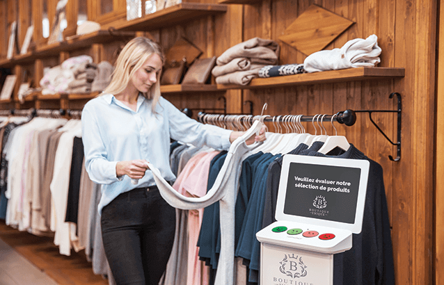 HappyOrNot Smiley Terminal - customer satisfaction measurement at clothing shop