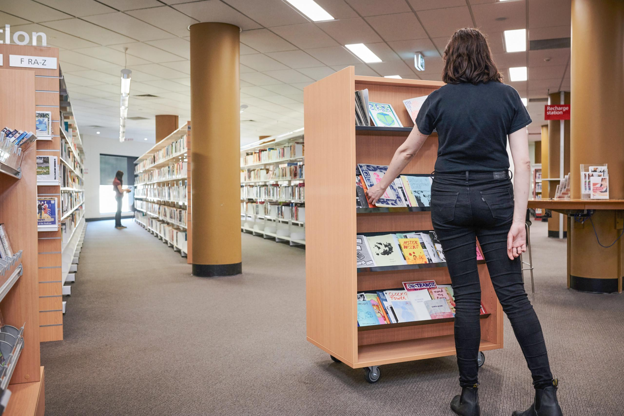 Woman standing in front of a shelf in the Hurstville Library