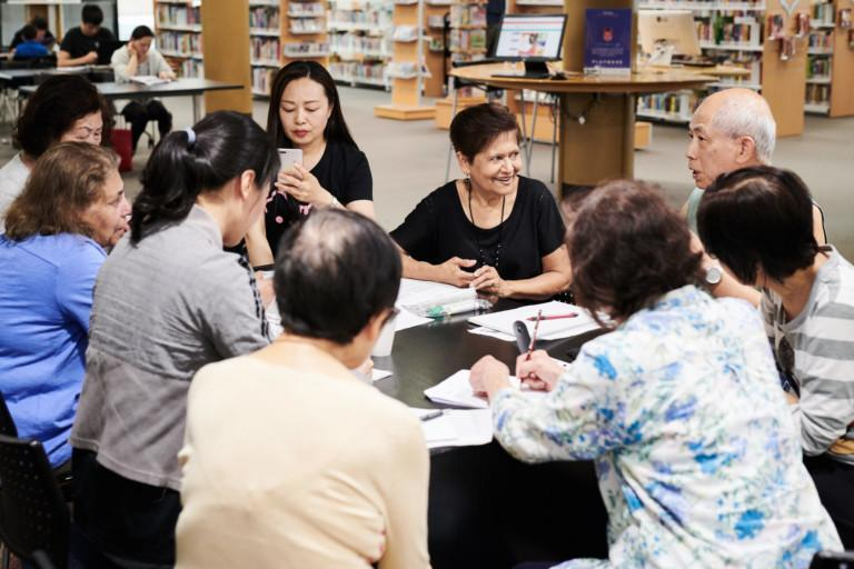 Racially and age diverse group of people sitting at a table in the Hurstville Library